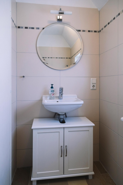 Ferienhaus Möwe Jonathan - Gästetoilette des Haupthauses